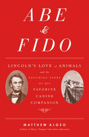 The cover of the book, Abe and Fido., which outlines reviews that Lincoln needed to find a home for a dog when he was moving to the White House.